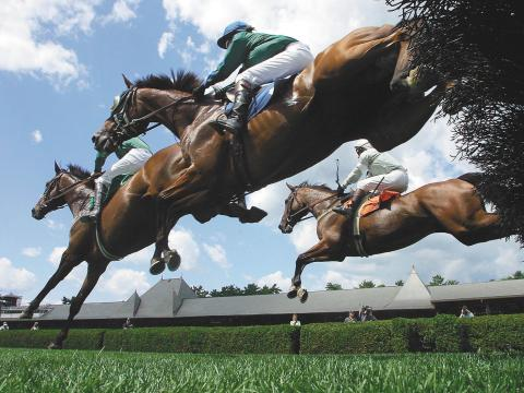 An exciting scene from the Saratoga Race Course Meet